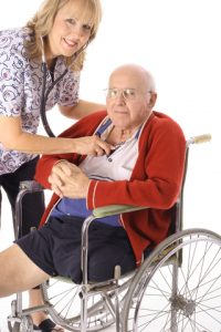 Sr_in_wheelchair_checking_BP